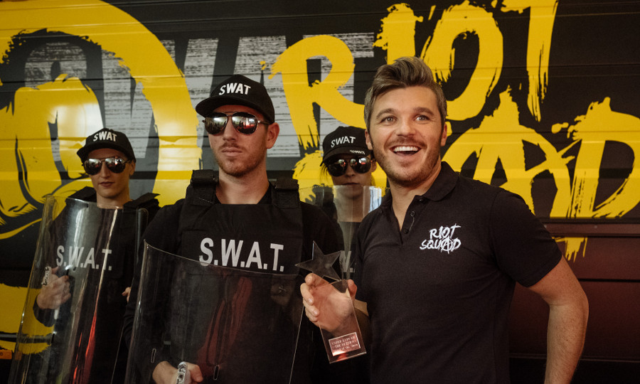 Ben Johnson with award and Riot Squad van - Toast Photography